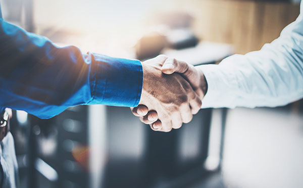 über uns - handshake 1 - Über uns